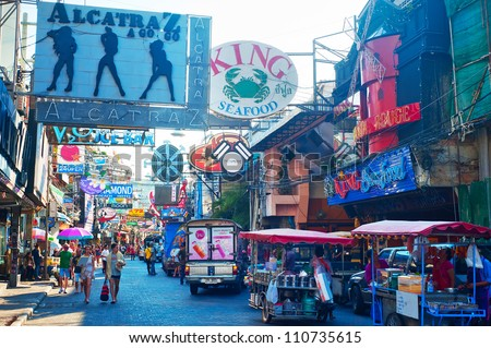 PATTAYA, THAILAND - MARCH 13: Walking street on March, 2012 in Pattaya. Walking Street  is a popular tourist attraction. Almost 20 million tourists visited Thailand in 2011.