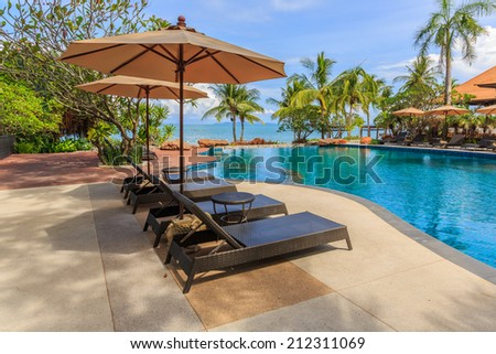 PATTAYA, THAILAND - SEP 7 : Pool chairs of Sea Sand Sun Hotel on Sep 7. The hotel consist of 60 boutique-style masterpiece Villas and Rooms, finest collection of Villa accommodation in the Pattaya. #212311069