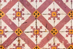 Patten geometrical national bright colored tiles laying from streets of Malaysia. Vintage of retro antique style