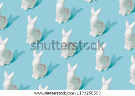 Pattern composition of Easter bunnies on pastel blue background. Minimalist isometric concept. #1193250553