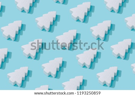 Pattern composition of white Christmas trees on pastel blue background. Minimalist isometric winter concept. #1193250859