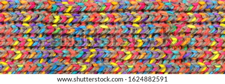 pattern fabric wool Background. relax autumn and winter season arrangement flat lay style. knitting wool scarf. knitted cloth from multi-colored woolen threads. multicolored woolen soft texture. Stock photo ©