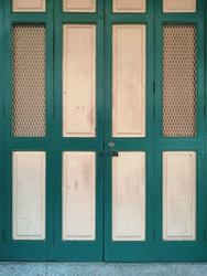Pattern for texture background : Green and white wooden doors of old vintage house in thailand