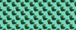 Pattern from dumpsters on a green background can be used as a background. The concept of ecology and waste sorting. Panoramic photo.