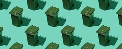 Pattern from dumpsters on a green background can be used as a background. The concept of ecology and waste sorting.