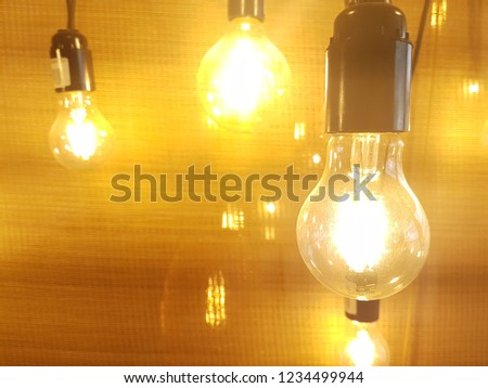 Pattern like light bulbs, old incandescent bulbs. Yellow light.