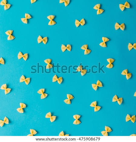 Pattern made of pasta on blue background. Flat lay.
