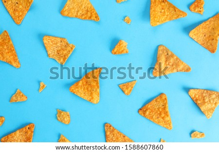 pattern mexican nachos chips on blue background top view
