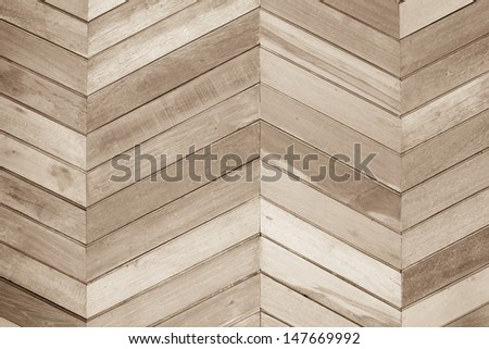 Pattern of aged wooden wall in zigzag shape
