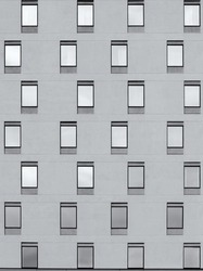 Pattern of building facade with symmetrical windows