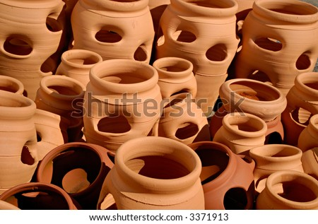 Pattern Of Clay Pots In One Color With Holes And Shadows