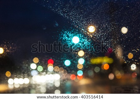 pattern of color in the windscreen of a car by night in rain Stock photo ©