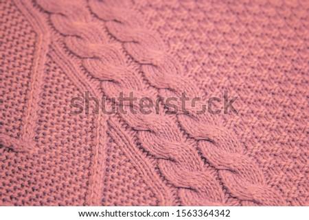 Pattern of colorful knitted sweaters closeup. Handmade merino wool product. Knitting patterns #1563364342
