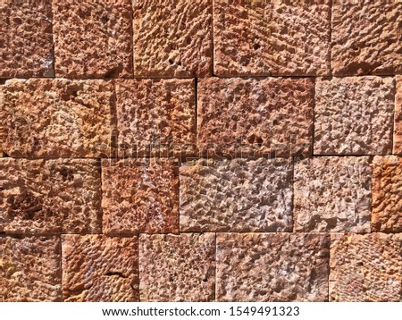 Pattern of decorative red stone wall background.Stone wall texture. random size stone wall.Background of stone wall.