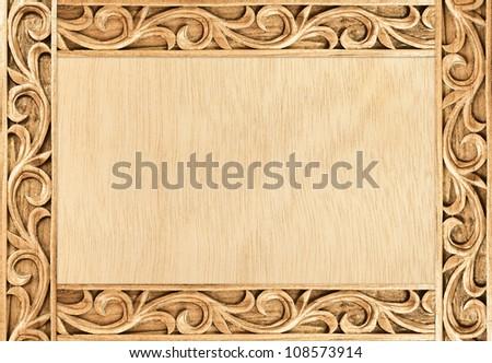 Pattern of flower carved frame on wood
