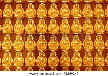 Pattern of golden wood carving buddha sculpture on chinese temple wall