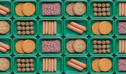 pattern of green trays with vegetarian meat substitute products, plant based mock meat