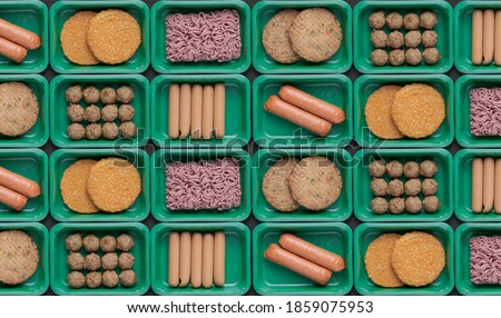 pattern of green trays with vegetarian meat substitute products, plant based mock meat ストックフォト ©