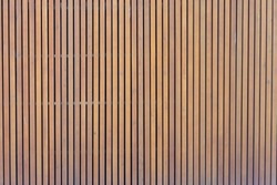 pattern of modern wall with vertical wooden panel, slats. background of wooden boards. wooden fence texture. wood plank with pattern for design and architecture