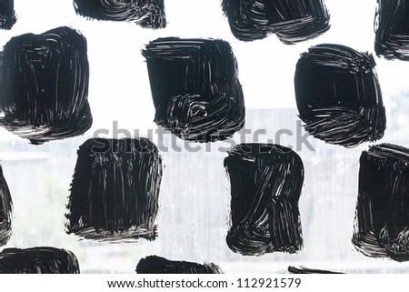 pattern of painted black and white glass facade