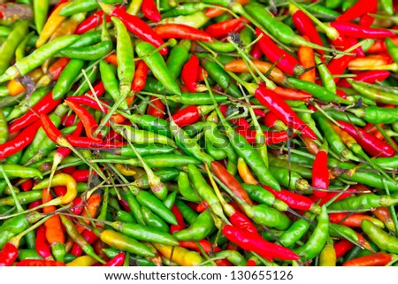 Pattern of red and green chili peppers