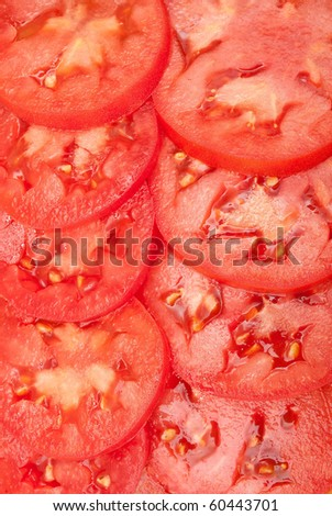 Pattern of red sliced tomatoes