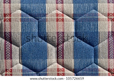 Pattern of retro furniture upholstery texture.Embossed background, grey hexagons, red and blue ornamental bands.