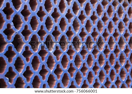 Pattern of rhombus and cross shapes on a wall #756066001