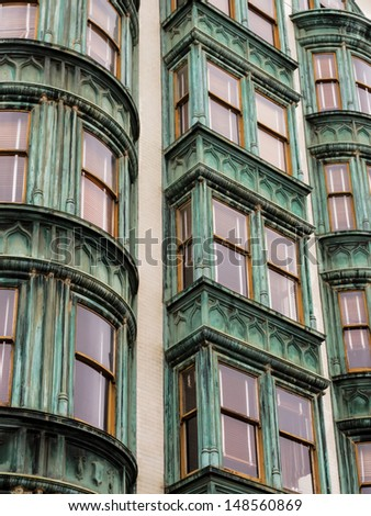 Pattern of row of vertical rows of windows in San Francisco apartment houses