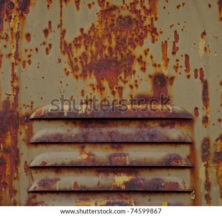 pattern of rusty metal air intake - stock photo