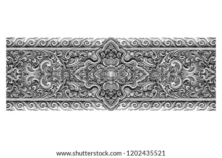 Pattern of silver metal plate with flower carved on white background Foto d'archivio ©
