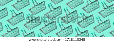 Photo of  Pattern of supermarket shopping basket on green background. Creative design for packaging. Online shopping. Seamless pattern. Black friday sale concept. Copy space. Sustainable, minimalist lifestyle