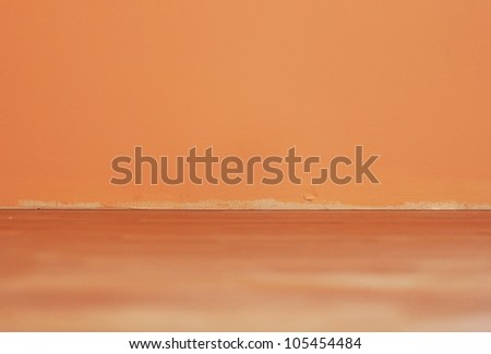 Pattern of the orange wall and wooden floor