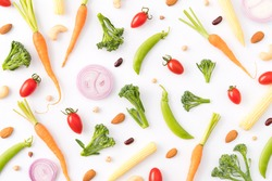 Pattern of vegetables and plant protein. Food background, Top view, Composition of carrot, tomato, shallot, baby corn, broccoli, snow peas with almonds, red bean on a white background. Balanced Vegan
