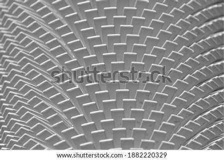 Pattern of white vanes on a heat dissipator or radiator. Part of utilites for a  northern town. Foto d'archivio ©