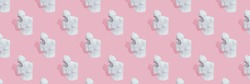 Pattern of white woman statue on pink background with hard shadow. Mental female health and loneliness concept.