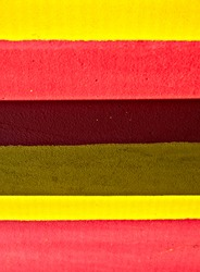 Pattern of wide red and yellow stripes, saturated and subdued.