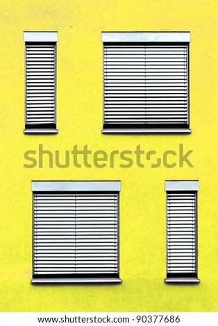 pattern of windows with red wall