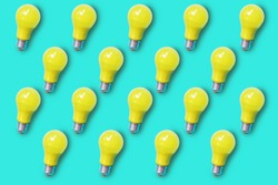Pattern of yellow light bulb on green turquoise background represent concept of idea , creativity , brainstorming and innovation
