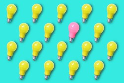 Pattern of yellow light bulb on green turquoise background with one pink light bulb , represent differentiation and unique concept
