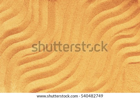 Pattern on the yellow sand, yellow wavy lines