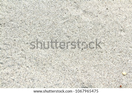 Pattern, surface and detail of gray sand on the tropical  beach