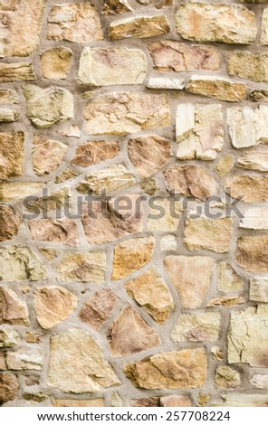 Pattern Vintage Color Texture of Modern Style Design Decorative Uneven Cracked Real Stone Wall Surface with Cement for Construction Work #257708224