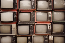 Pattern wall of pile old retro television (TV) - vintage filter effect style.