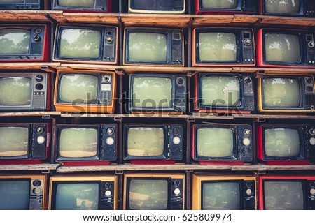 Pattern wall of pile old retro TV ,With vintage filter effect style. #625809974