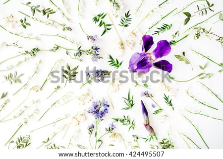 Pattern with purple iris and lily of the valley flowers on white background. Flat lay, top view