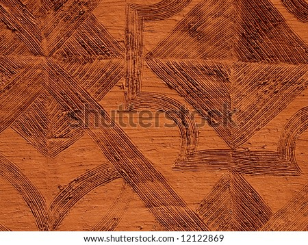 Patterned mud wall of a traditional South African Basuthu hut