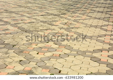 patterned paving tiles, old cement brick floor background #633981200