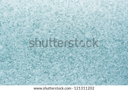 Patterns on glass in the frosty winter day. Christmas background