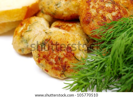 patties on a plate with dill and bread